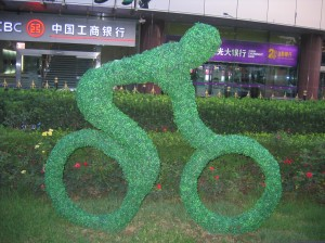 A leafy sculpture of an Olympic cyclist in Beijing