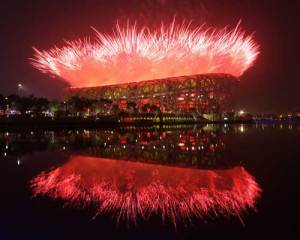 "Fireworks explode over the ""Bird's Nest"" during the Opening Ceremonies"